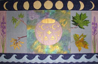 Womanhood blanket with Salish Owl by Chris Paul. Moon phases, mapple leaves depicting seasons and camas.